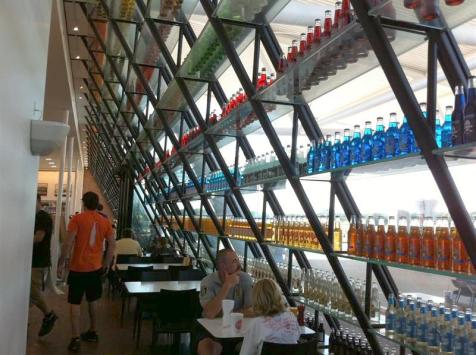 View from near our table inside. Each shelf has about 24 of the same colored pop glued to the glass shelf.