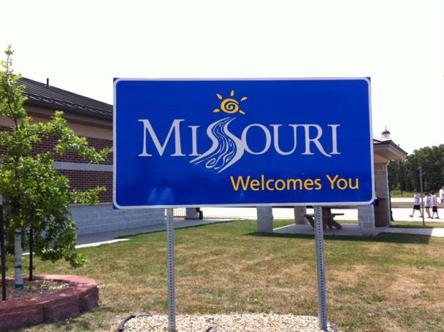 Welcome to Missouri. Getting a welcome sign at the rest stops ensures better success than snapping the sign from the car at 70 MPH. It was easier going south because the exit number go DOWN to zero so you can keep track of it easier. Going north, they go higher. Suddenly you're at exit #267 or whatever - yikes, where's the iphone??!!!