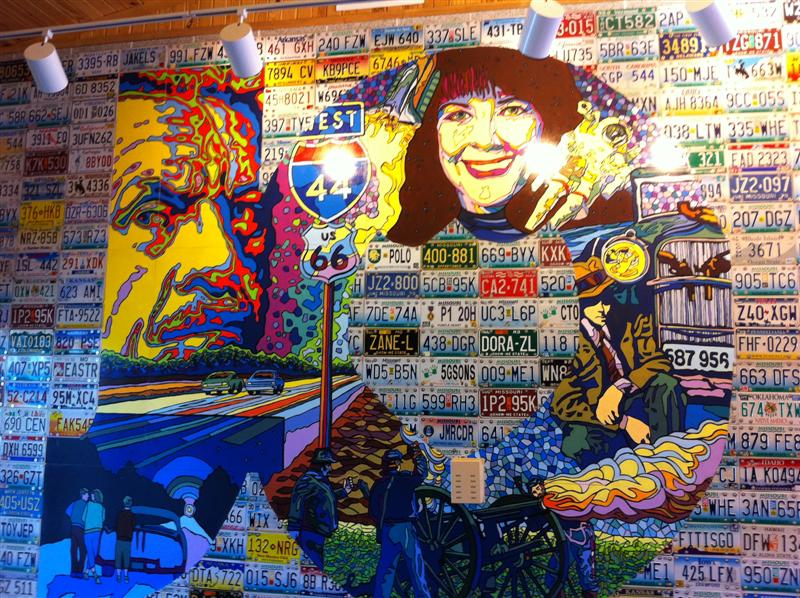 Inside the lobby of the Welcome Center an artist had made a collage using license plates from all over the US. The pictured part spelled JOPLIN. Shown here is the JO. Wouldn't this make a cool garage wall?