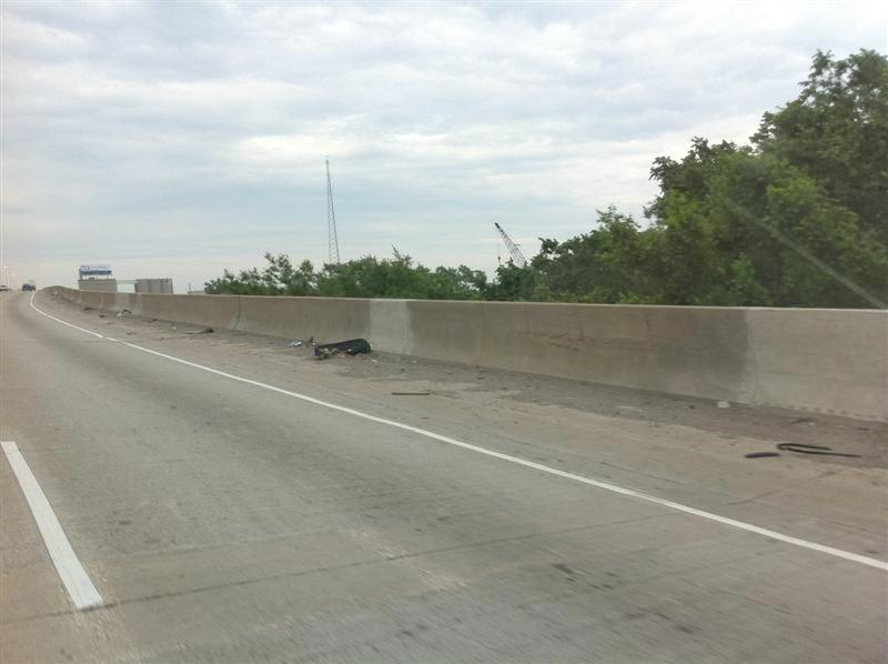 Detroit scene on I-75. We have travelled this stretch many times over the last 35+ years. When DW & Christopher (our sons) were younger we would always comment on the various items discarded along the interstate in Detroit. There have been mattresses, tires, chairs. Today I just missed getting a picture of a soggy mattress. This picture doesn't show the extent of the trash. Don't recall seeing another interstate or road like it.