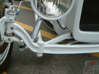 A torsion bar sits inside the frame rails, and the arm fits into a slot in the hairpins.