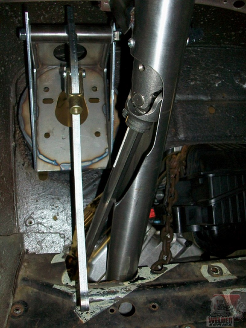 The steering linkage on this Plymouth with a Hemi had to be routed to just about where the brake pedal is. Grant installed a U joint halfway down the column and kicked the shaft out before the toeboard. Slick!