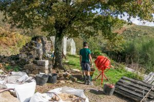 Building a stone wall on a workaway project in Galicia