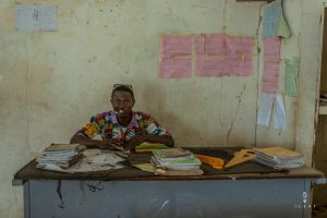 African teacher at his desk