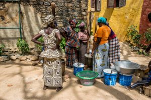 Women cooking on the street in Senegal. Teranga