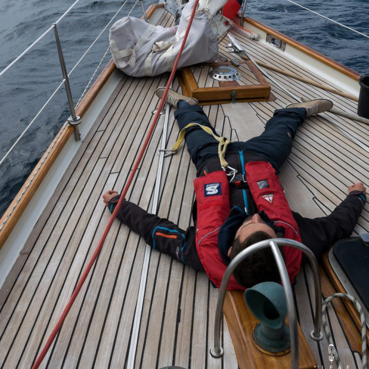 Sailer sleeping on deck