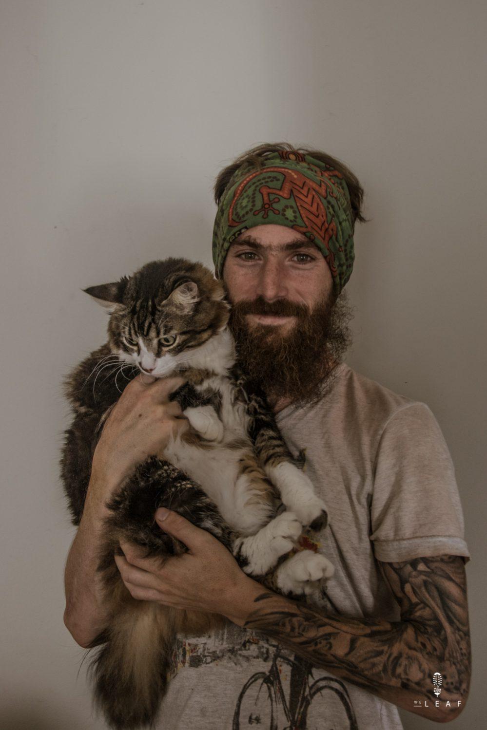 Tattooed Brazilian with his cat