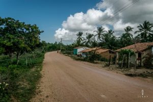 Cycling in Brazil on a dirt road through a small community