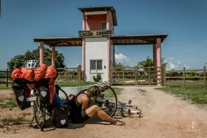 Cyclist repairing a tyre in Brazil