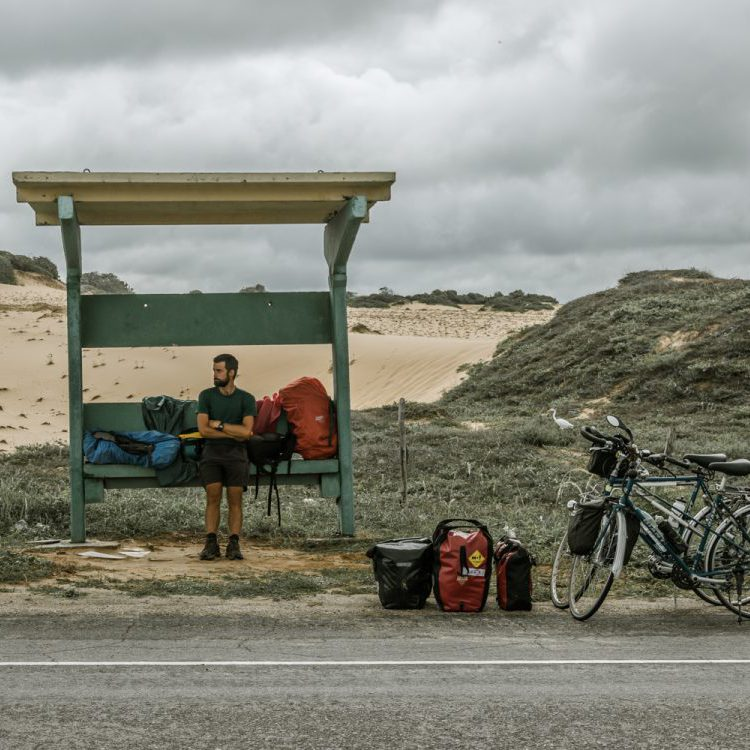 Cyclist waiting for the bus in Brazil