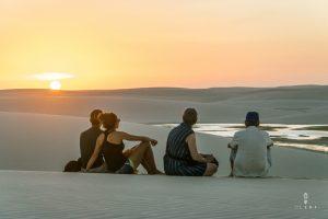 Family watching the sunset in lencois maranhenses