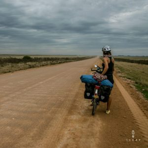 Cyclist on a endless dirt road in Uruguay