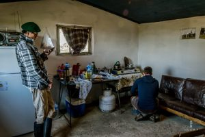 Cooking diner inside the humble house of a gaucho in Uruguay