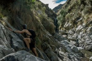 Rock climbing to reach a waterfal