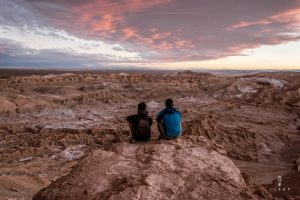 Brothers watching the sunset in Valle de la Luna