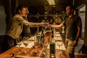 Friends doing wine tasting in a bodega in Cafayate