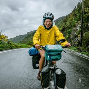 Cyclist in yellow raincoat on the Carretera Austral