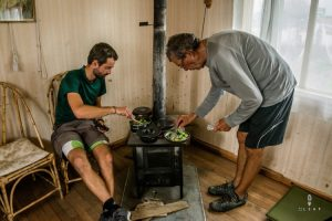 Cyclists cooking diner on a Russian stove