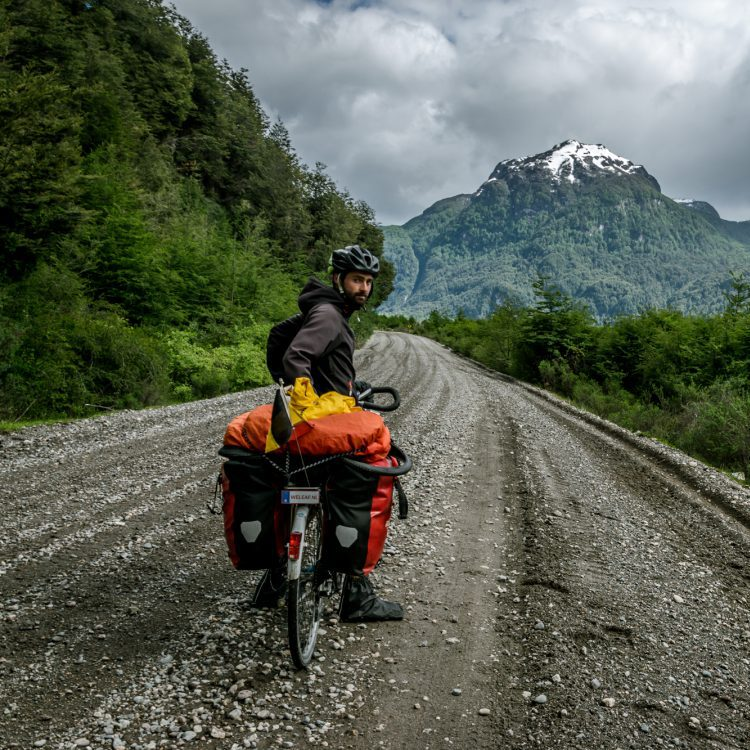 Cyclist on a ripio road on the Carretera Austral