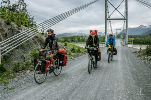 Cyclists crossing a bridge on the Carretera Austral