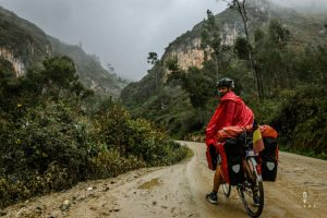 cycling in the rain on a dirt road