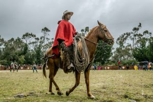 man on horse with traditional clothes in Ecuador