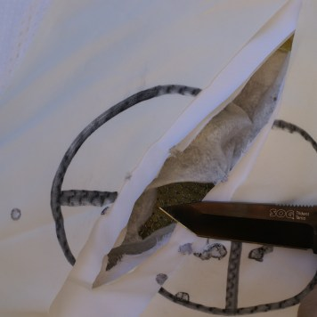 While the outer carrier and panel liners were cut through, the maille that is front of the Kevlar stopped every attack from every blade. In fact, the knife shown here completely lost its edge.