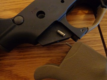 At this point the grip and safety will need to be removed. The safety detent is located under the grip, and is small and easy to lose.