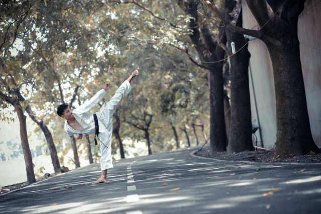 asian young teen man doing karate kick by the street | types of martial arts | types of martial arts self defense | all types of martial arts