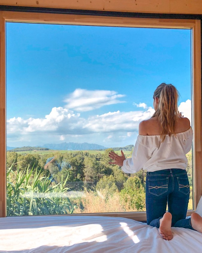 Woman Looking Out Tiny Home Window