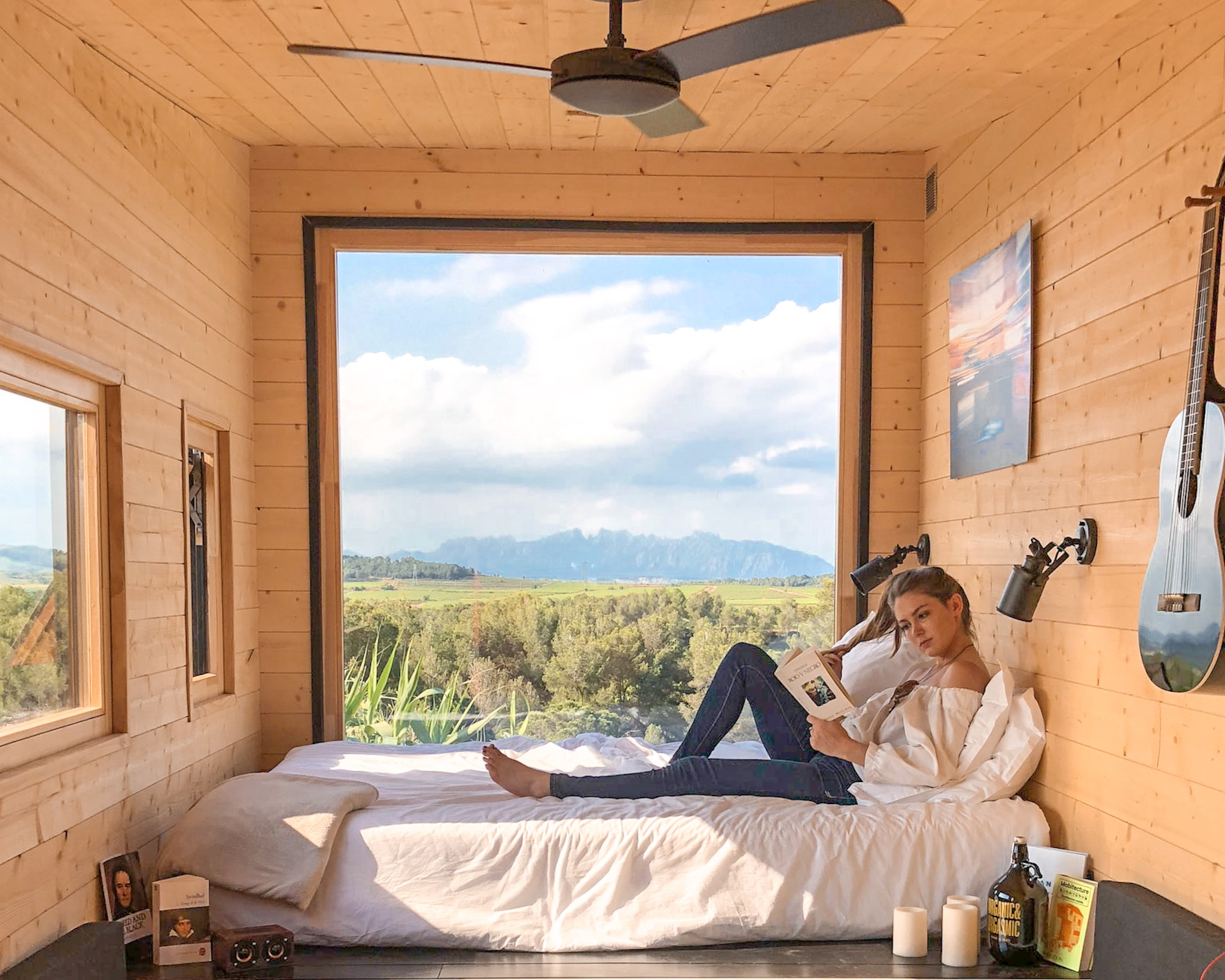 Woman Reads in Tiny Home
