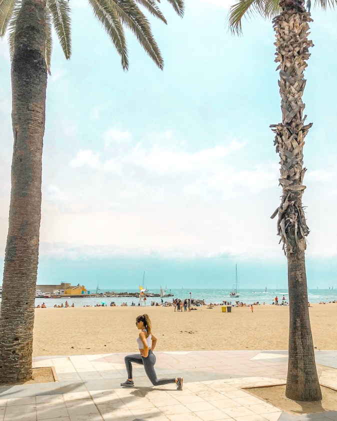 Woman Does Lunges at Barcelona Beach