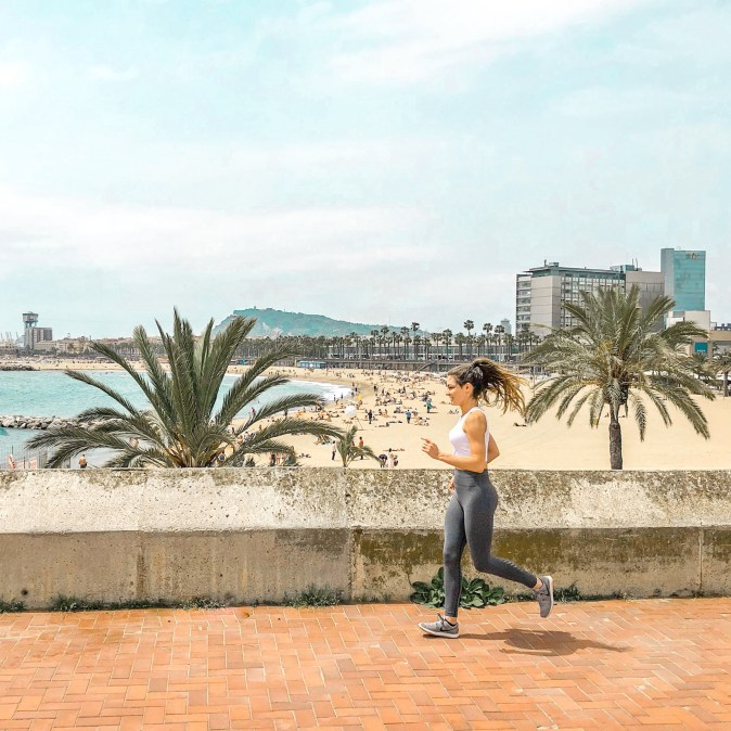 Woman Running at Barcelona Beach