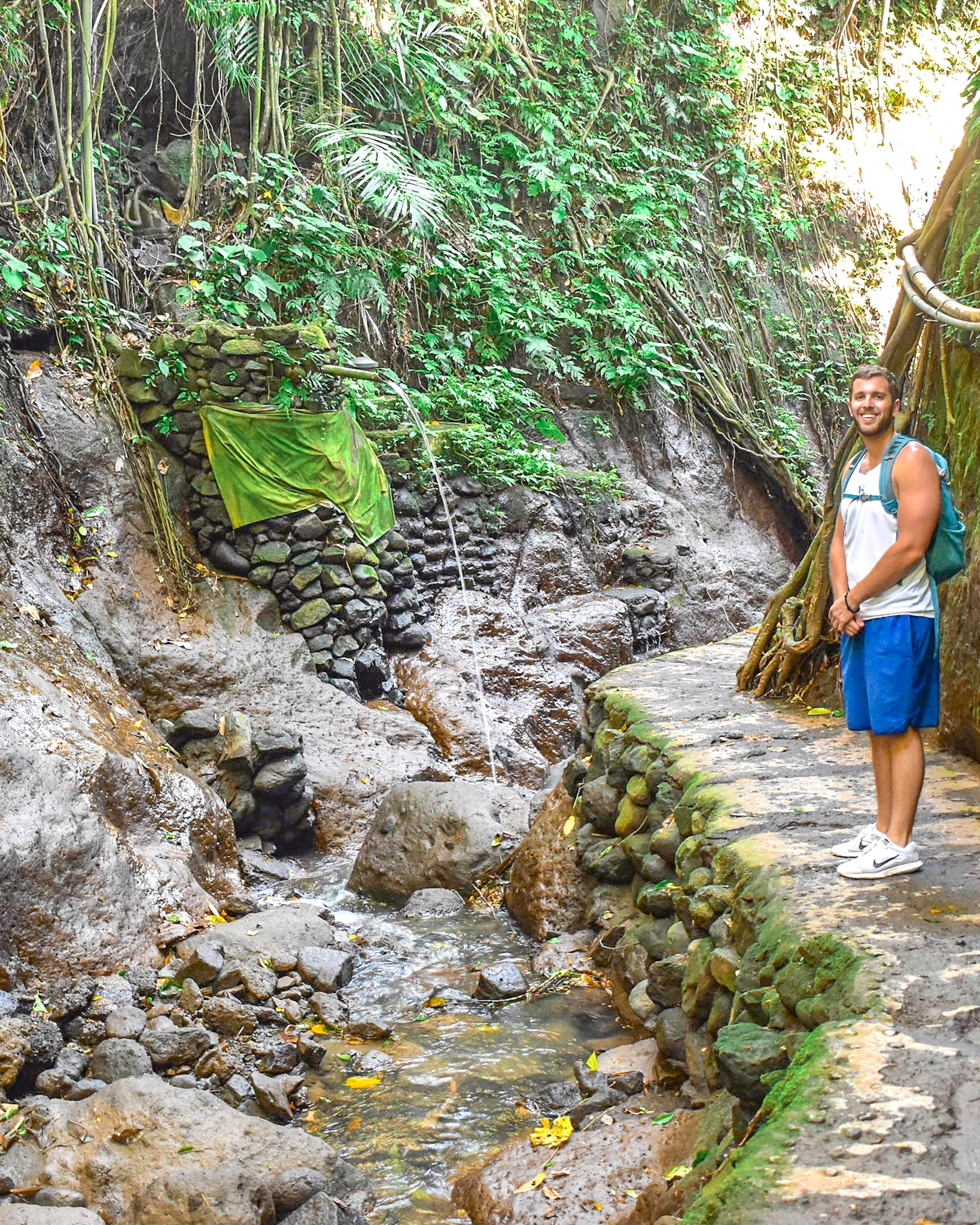 Man Checks Out the Jungle at Ubud Monkey Forest