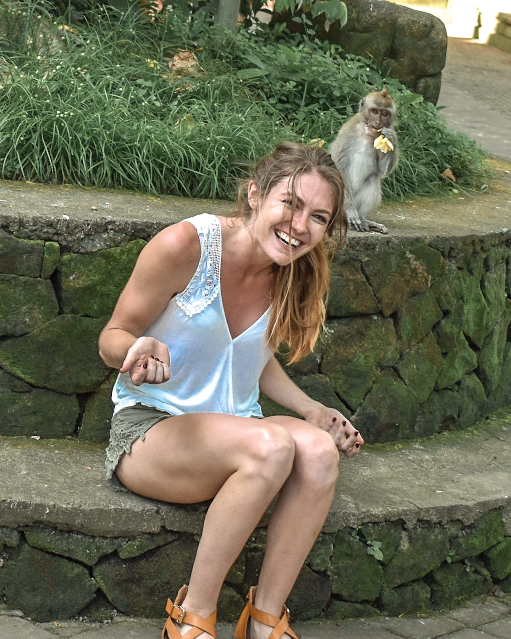 Monkey Steals Flower Out of Woman's Hair at the Ubud Monkey Forest