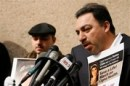 Krikor Sarkisian, right, father of Natalee Sarkisian, speaks as his son Bedros listens, during a news conference in Los Angeles, Friday, Dec. 21, 2007. The family of the 17-year-old girl, who died hours after her health insurer CIGNA reversed a decision and said it would pay for a liver transplant, plans to sue the company, their attorney Mark Geragos said Friday. (AP Photo/Matt Sayles)
