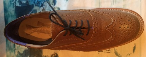 Laced as you would lace your trainers, with the traditional knot all kids learn.