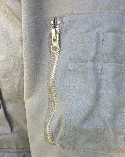 Zipped pocket on arm, with space for slim objects.