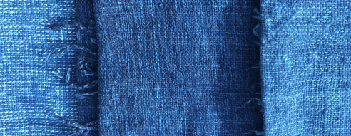 From left to right: Original indigo and washed super-indigo scarves.