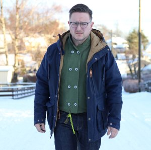 Worn fully buttoned up with mountain parka.