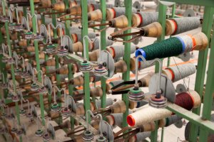 For a single width loom 696 ward threads have to be arranged in the correct order, and delivered ready to beam.