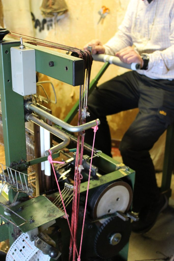 A double-width loom is powered by pedals.