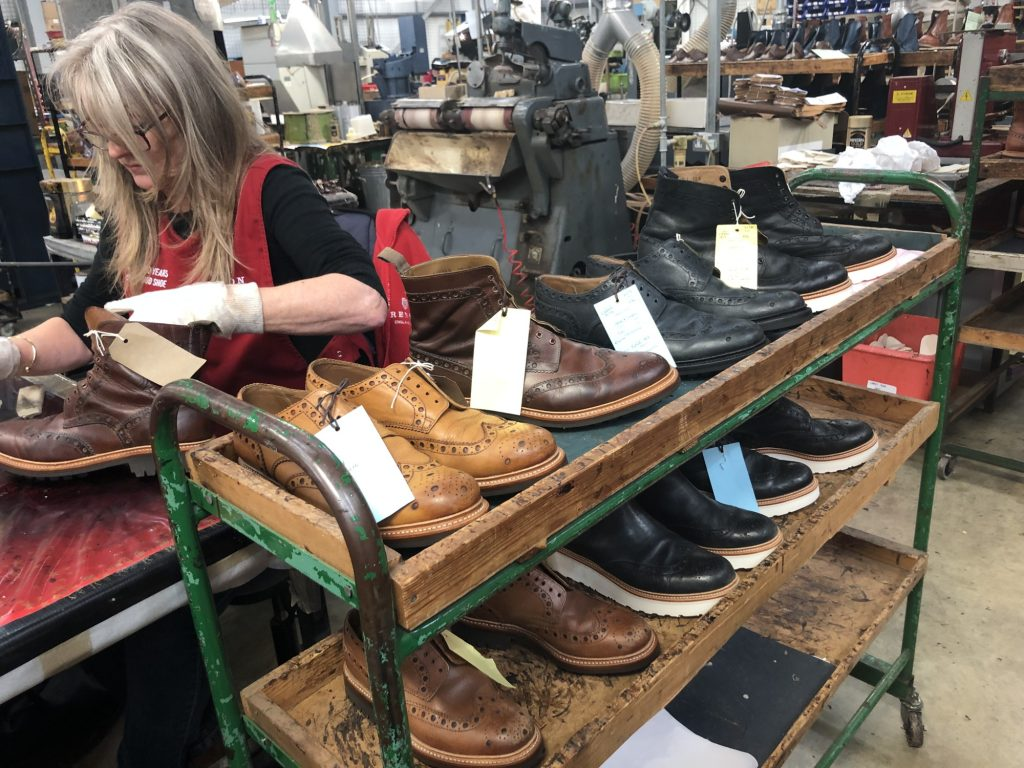 Customers shoes being given the final polish after being refurbished at Grenson.