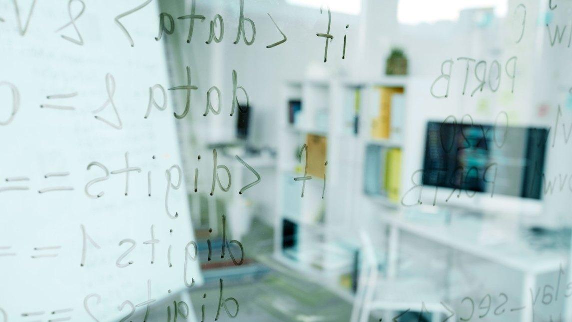 mobile app code written on glass