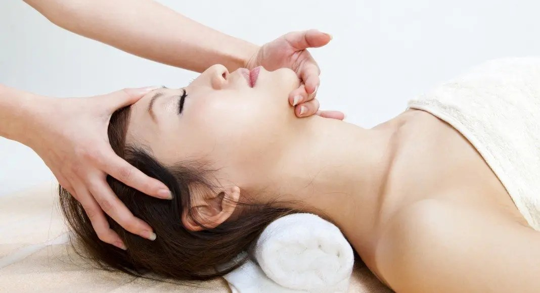 lady on massage table treatment for migraine