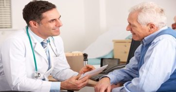 blog picture of doctor and elderly patient speak