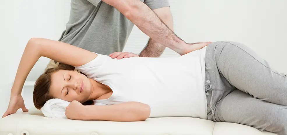 chiropractor works on patient