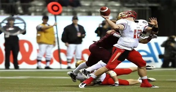 blog picture of football quarterback getting hit from behind