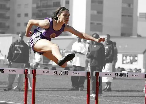 blog picture of young girl jumping hurdles