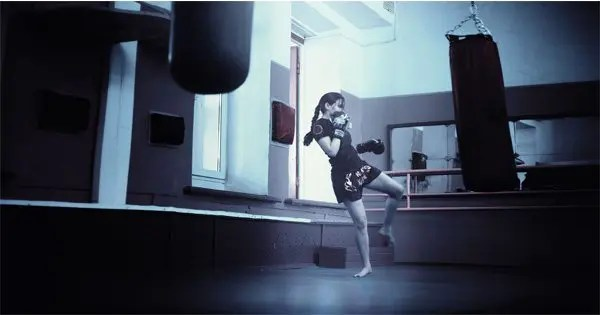 blog picture of female kick boxer practicing